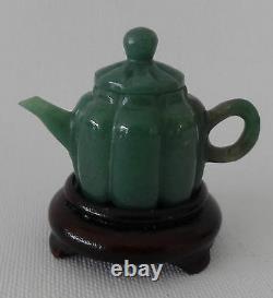 Set of eight vintage carved semi-precious stone miniature tea pots